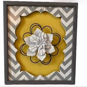 Yellow and gray hanging picture with metal flower